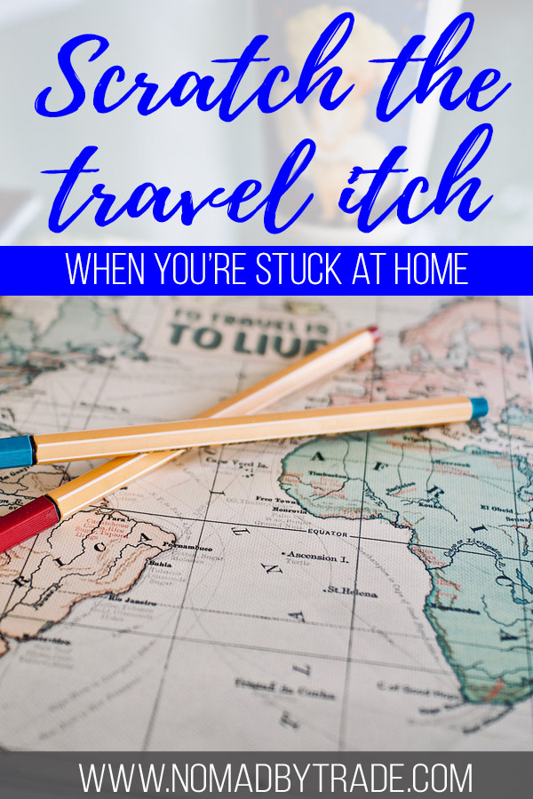 """Photo of a map with text overlay reading """"Scratch the travel itch when you're stuck at home"""""""