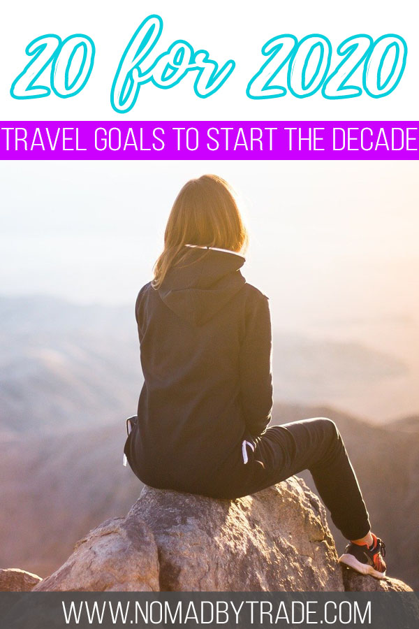 """Woman sitting atop a mountain with text overlay reading """"20 for 2020 - Travel goals to start the decade"""""""