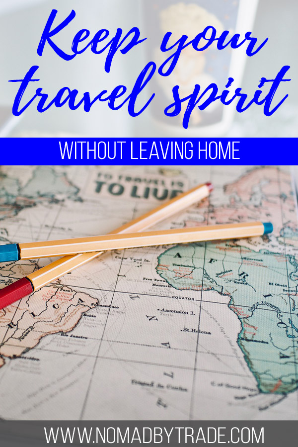 """Photo of a map with text overlay reading """"Keep your travel spirit without leaving home"""""""