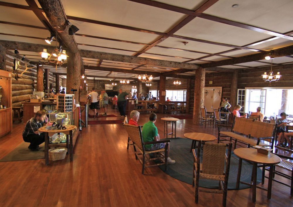 Large wood framed lobby filled with guests seated or milling around