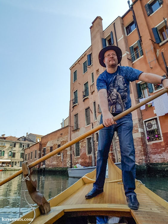 Gondolier rowing in Venice's canals