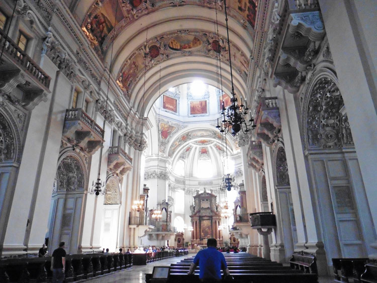 Ornately decorated ceiling of the Salzburg Cathedral, part of a one day in Salzburg itinerary