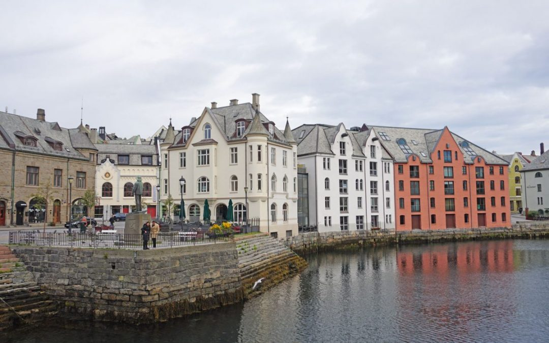Art Deco buildings reflected in the water - one of the top free things to do in Alesund, Norway
