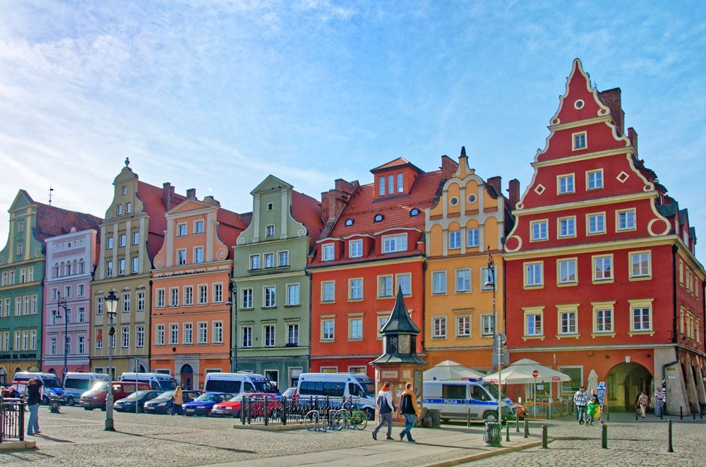 Visiting the brightly colored buildings in historic cities like Poznan is one of the top things to do in Poland