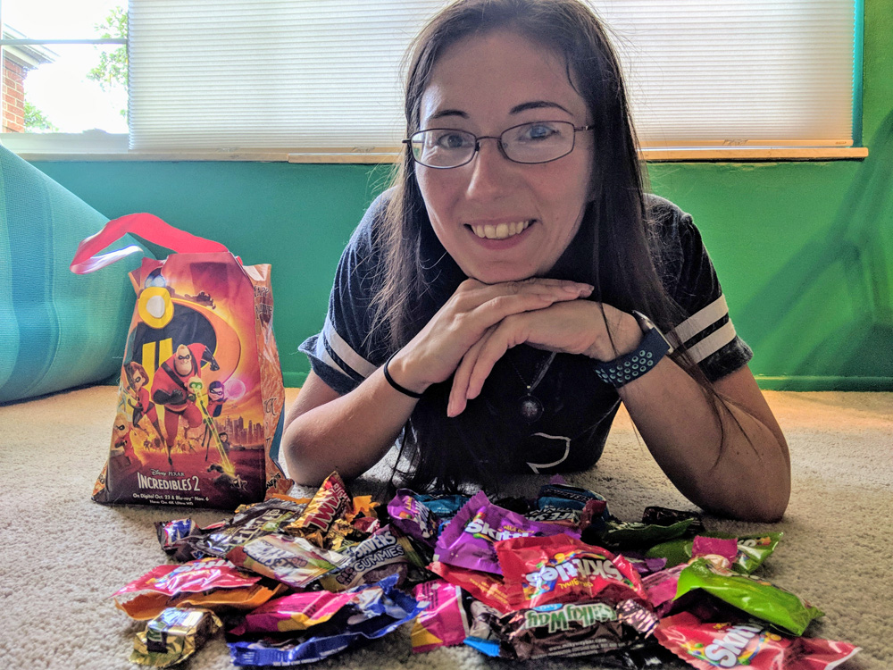 Woman with a pile of candy from Mickey's Not So Scary Halloween Party