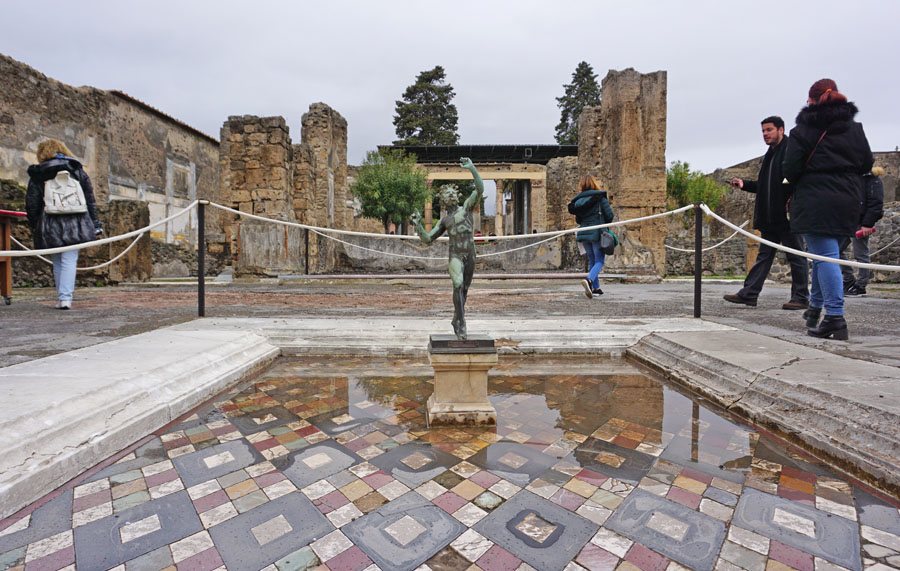 Pool and statue in the House of the Faun in the Pompeii Archaeological Park