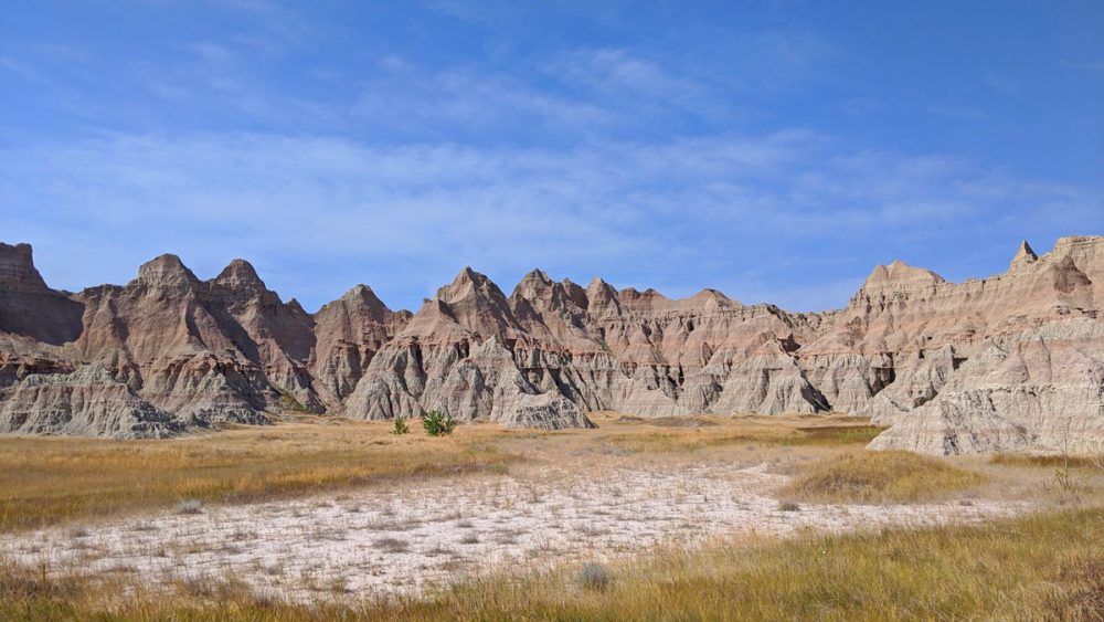 Rock formations in front of a grassy area in Badlands National Park