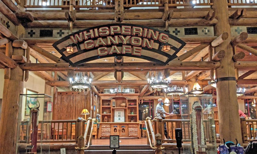 Wooden stairs and carved sign reading Whispering Canyon Cafe