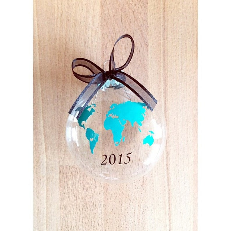Glass ornament with globe and custom year